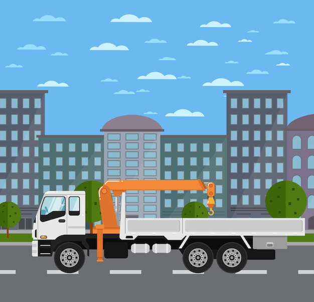 Truck mounted crane on road in city