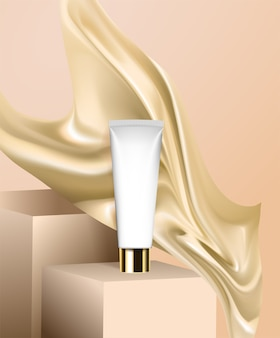 A tube of cream is on the podium, fabric and silk are flying nearby.