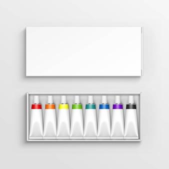 Трубы краски в упаковочной коробке изолированы