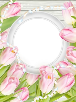 Tulips and blank white frame.
