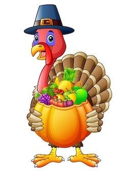 Turkey holding pumpkin basket full of fruits and vegetables