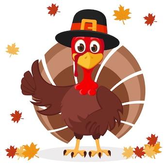Индейка в шляпе показывает, как на белом фоне с осенними листьями. день благодарения.