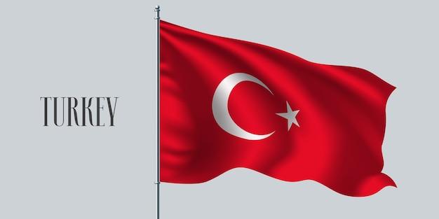 Turkey waving flag on flagpole.