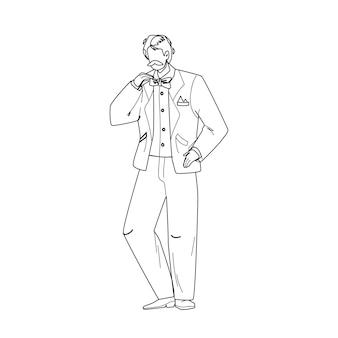 タキシードと蝶ネクタイを身に着けている若い男