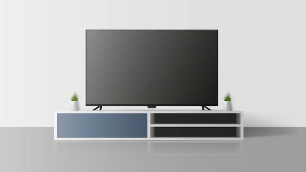 Телевизор на серой стене. выключаю телевизор, длинную тумбочку-чердак.