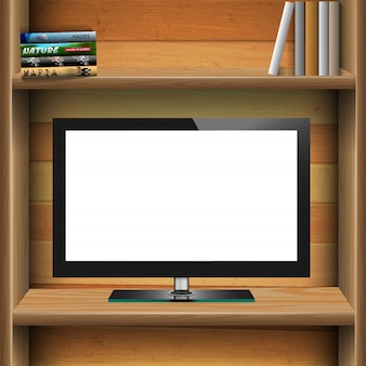Tv widescreen lcd monitor on wooden shelf with books