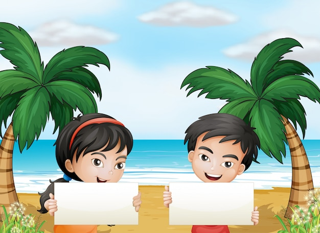 Two adorable kids at the beach with empty signboards