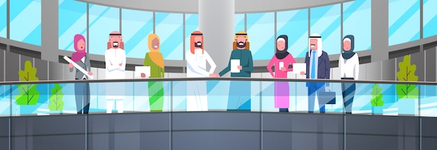Two arab businessman leaders handshake over team of muslim business people in modern office partnership and agreement concept horizontal illustration