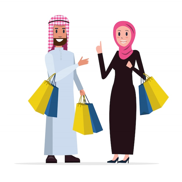 Two arab people coming out of shopping with bags