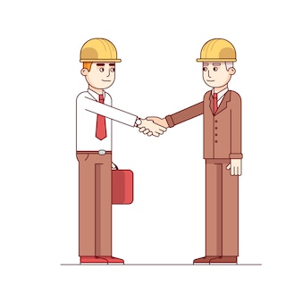 Two architects or building engineers shaking hands