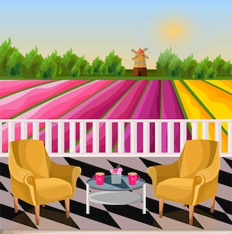 Two armchairs terrace view. rural background with mill and flower fields
