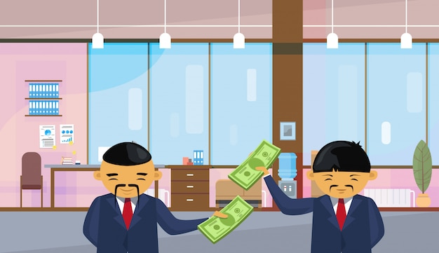 Two asian business men holding dollar banknotes standing