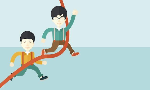 ラインをフィニッシュするために実行している2つのアジア人の男。
