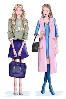Two beautiful stylish girls with bags