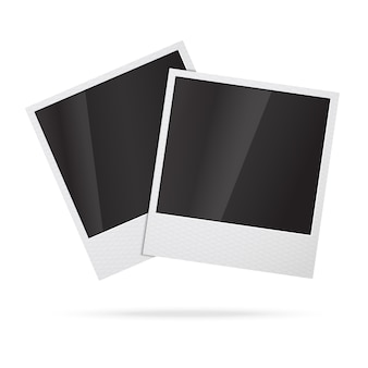 Two blank instant photo frames.