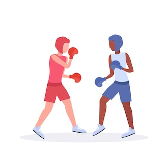 Two boxers exercising thai boxing couple mix race fighters in gloves and protective helmets practicing together training concept fight club healthy lifestyle concept  white background