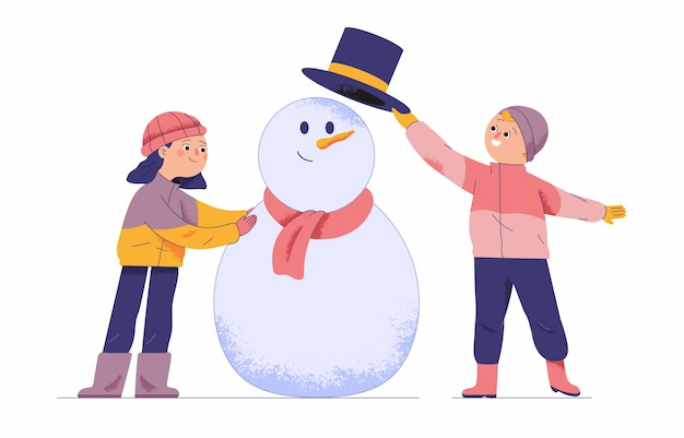 Two boys and a girl play snowball statues during the holidays and winter