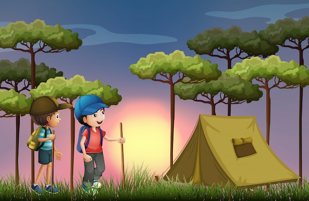 Two boys hiking and camping in the forest