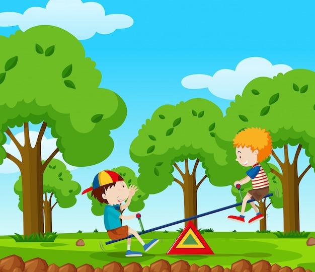 공원에서 시소를 재생하는 두 소년