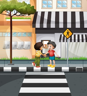 Two boys waiting to cross the road