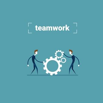 Two businessman holding cog wheel teamwork cooperation concept