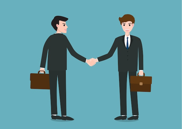 Two businessman standing and shaking hands with happy faces.