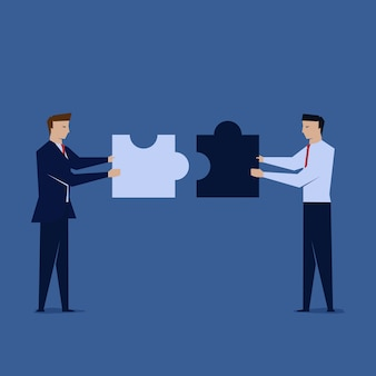 Two businessman unite the puzzle