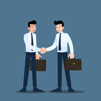 Two businessmen shake hands each other.