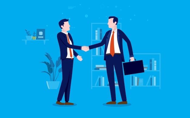2人のビジネスマンがオフィスで握手して取引を行い、合意に達する