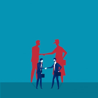 Two businessmen shaking hands with shadow