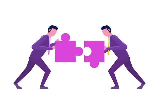 2人のビジネスマンがパズルを結合