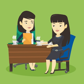 ビジネス会議中に2人のビジネスウーマン。