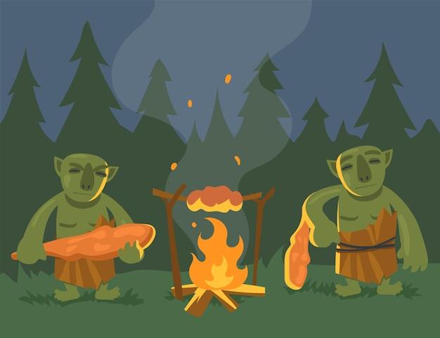 Два мультяшных зеленых тролля возле костра плоской иллюстрации. злые орки или монстры с дубинками готовят ужин на костре в ночном лесу. компьютерная игра, фэнтези, сказка, концепция монстра