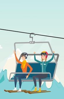 Two caucasian skiers using cableway at ski resort