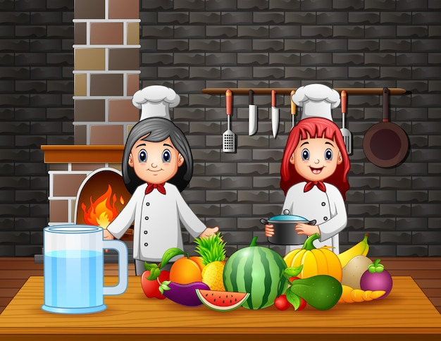 Two chefs preparing food at the dining table