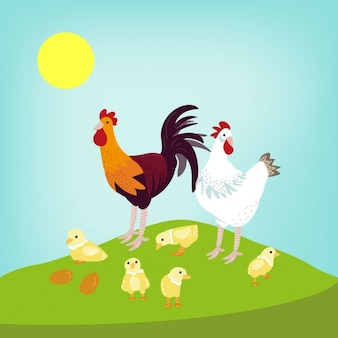 Two chickens on a green hillside