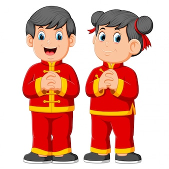 Two children are giving a greeting for a chinese's new year