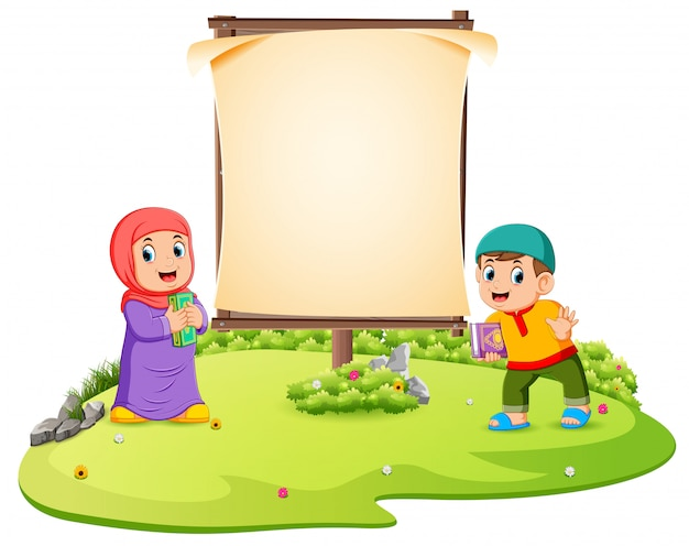 Two children are standing in the green garden near the blank frame