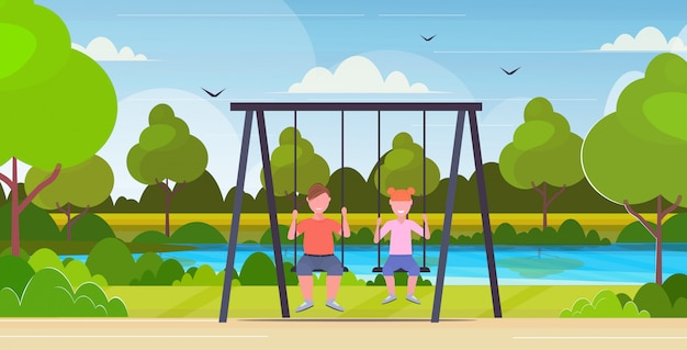 Two children  boy and thin girl sitting on swing unhealthy lifestyle obesity concept kids swinging together having fun outdoor summer park landscape background flat full length horizontal