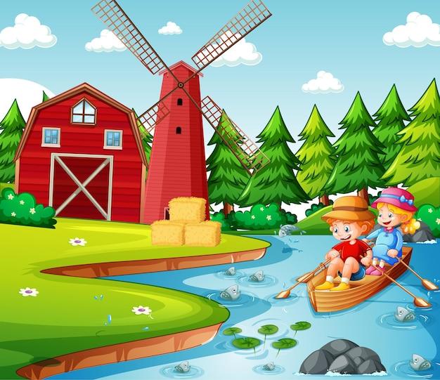 2人の子供が川の農場のシーンでボートを漕ぐ