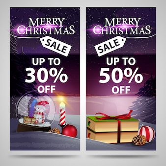 Two christmas banners with beautiful winter landscape, christmas books and snow globe