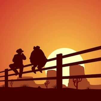 Two cowboy silhouettes were sitting on a wooden fence