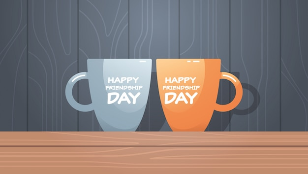 Two cups on wooden table with text happy friendship day celebration