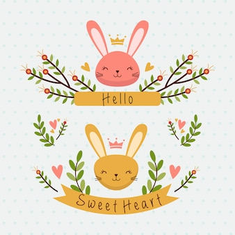 Two cute bunny head with floral and ribbon
