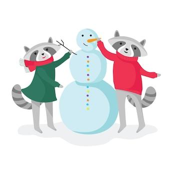 Two cute raccoons making snowman
