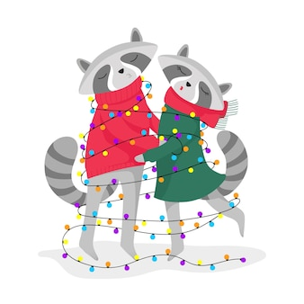 Two cute raccoons wrapped in a christmas tree garland