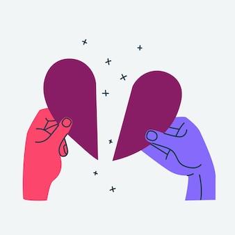 두 개의 다른 색깔의 손이 찢어진 심장을 잡고 있다