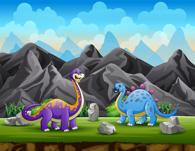 Two dinosaurs at the mountain cliff background