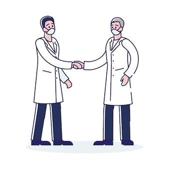 お互いに握手する2人の医師