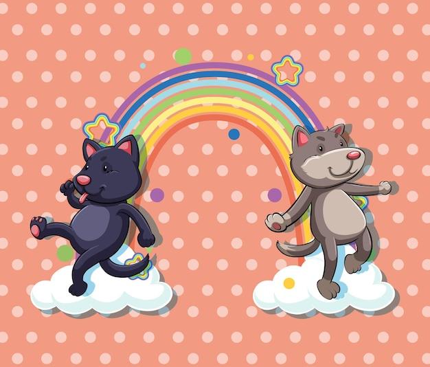 水玉模様の背景に虹と雲の上の2匹の犬